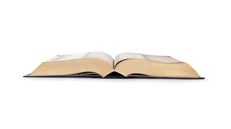 Opened book isolated on white background. Opened book lying isolated on white background royalty free stock photo