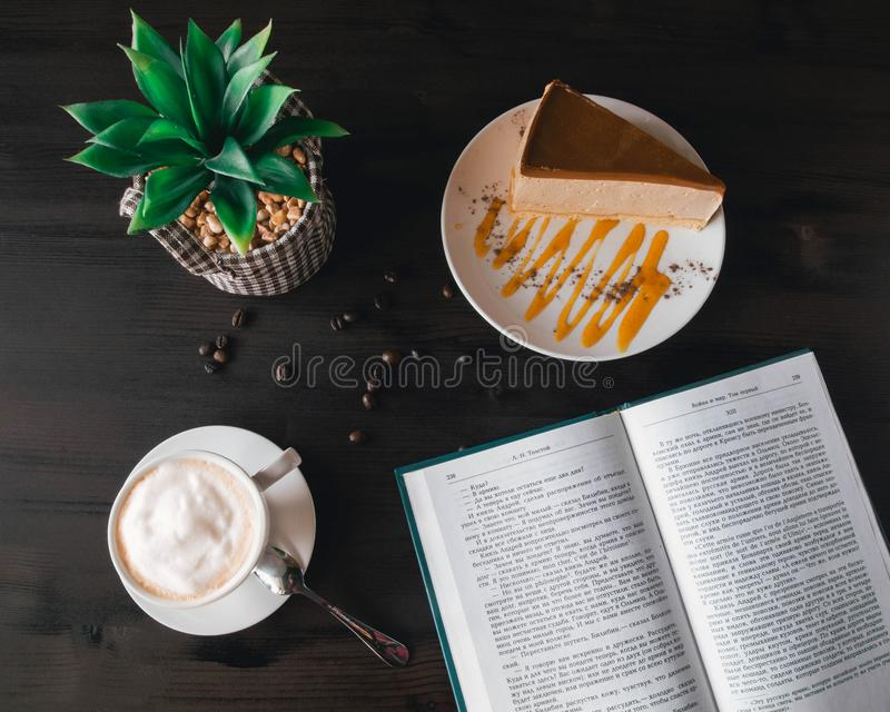 Opened Book Near Custard Cake and Coffee stock photography