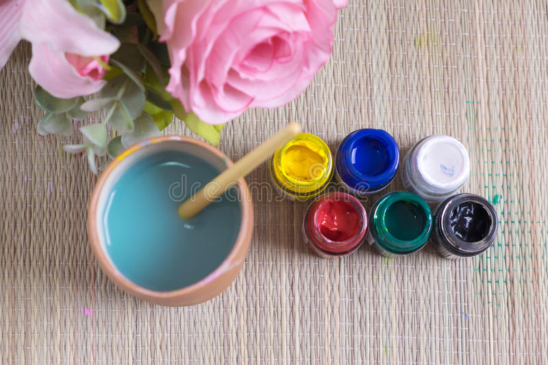 opened bottles of poster paint stock image