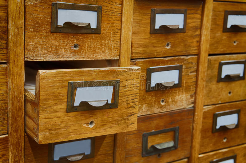 Opened box archive storage, filing cabinet interior. Vintage wooden boxes with blank index cards. library service and. Information management concept royalty free stock image