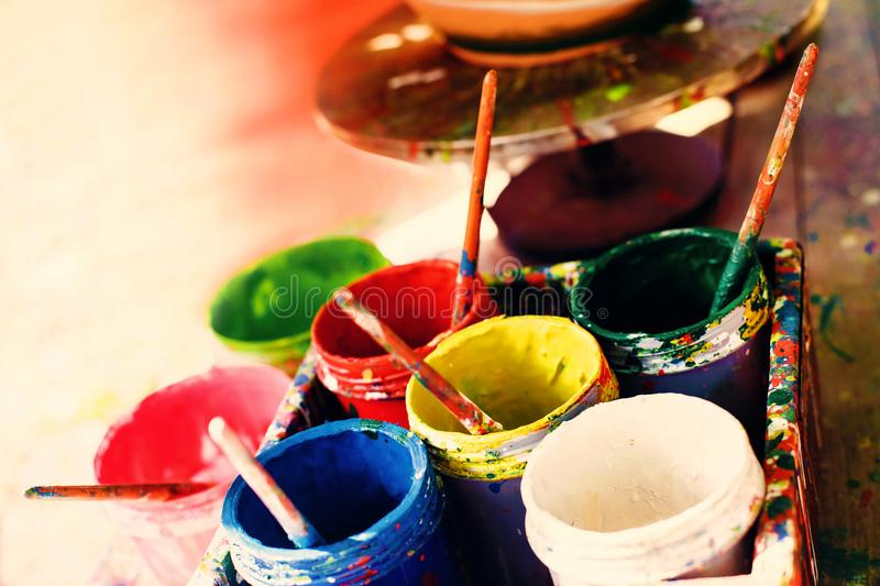 Opened colorful cans with paint stock photo