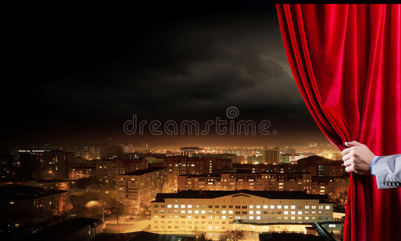 Opened curtain. Hand of businessman opening red velvet curtain royalty free stock photos