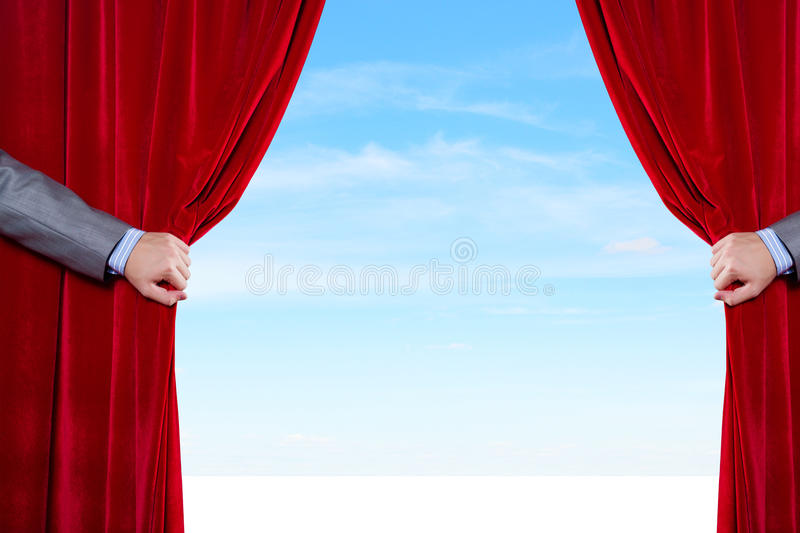 Opened curtain. Hand of businessman opening red velvet curtain stock images
