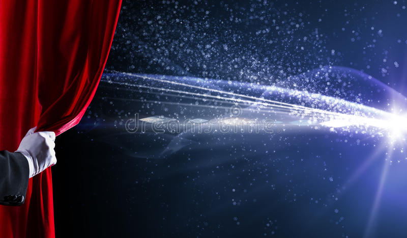 Opened curtain. Human hand in white glove opening red velvet curtain royalty free stock images
