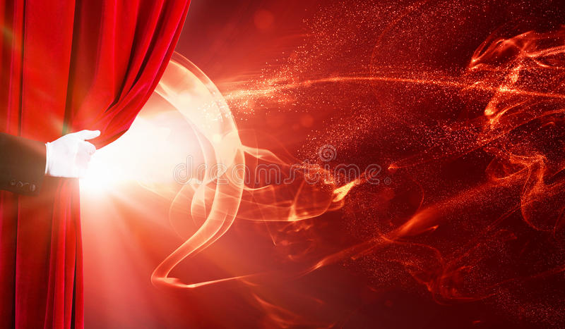 Opened curtain. Human hand in white glove opening red velvet curtain royalty free stock photo