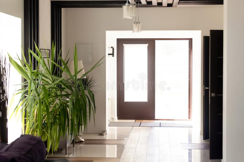 Opened door of modern luxury home waiting for new owners stock photos