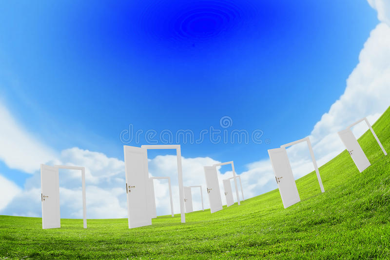 Opened doors in field. Conceptual image with opened doors as new way entrance to new world stock image