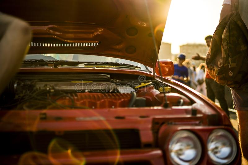 Opened fast race muscle car bonet during a sunset royalty free stock photos