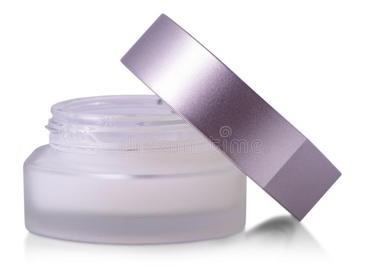 The opened glass jar of beauty cream with cap isolated on white background. Opened glass jar of beauty cream with cap isolated on white background stock images