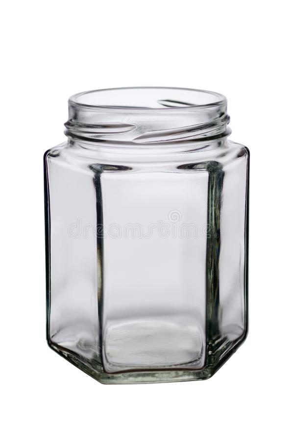 The opened glass jar of an unusual form with sides on a white background.  royalty free stock photos