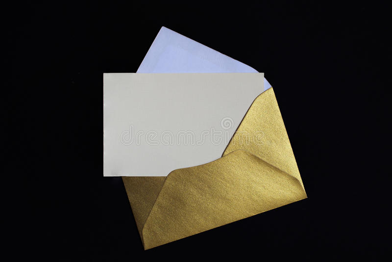 Opened golden envelope on black background stock photos