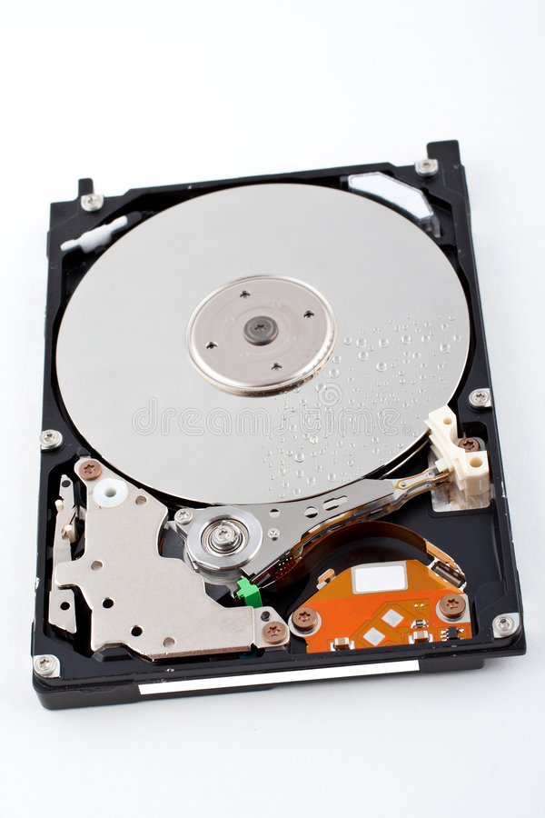 Opened hard disk drive, with water drops royalty free stock photography