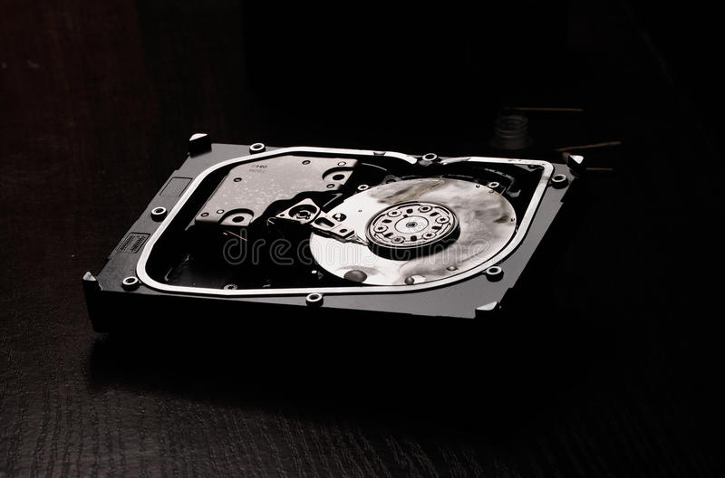 Opened hard disk after the fire stock photo