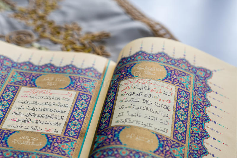 Opened holy book quran in pages of fatiha and bakara recitations stock photo