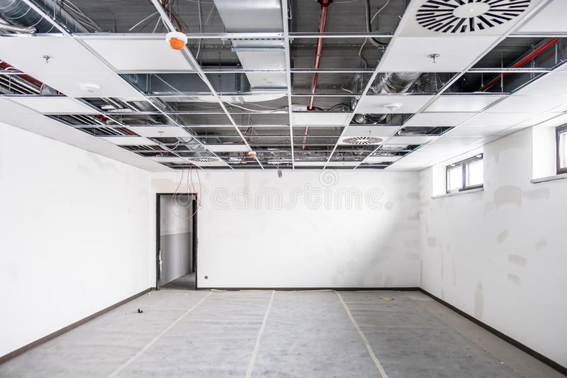 Opened hung ceiling. At construction site stock photography