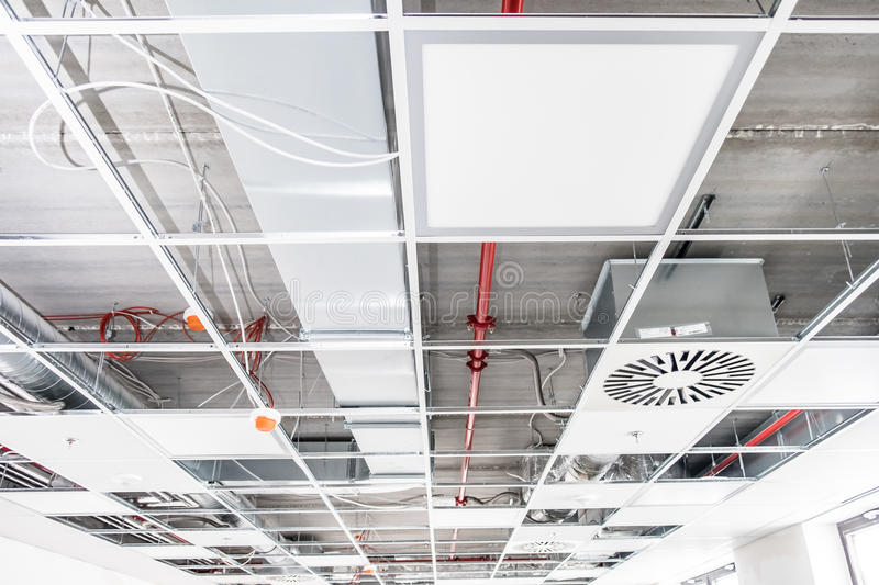 Opened hung ceiling. At construction site royalty free stock photo