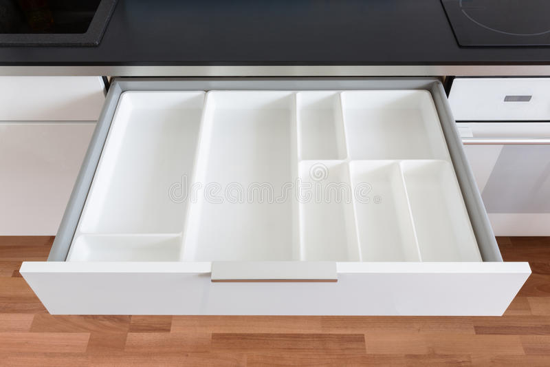 Opened kitchen drawer stock photography