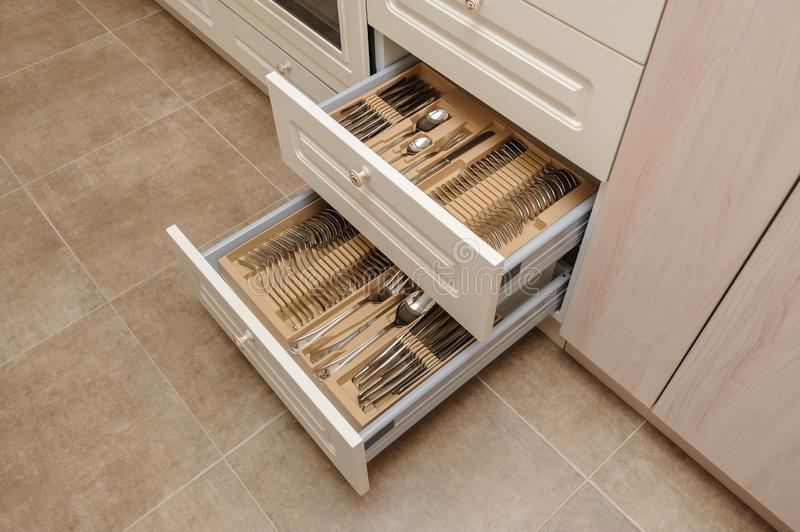 Opened kitchen drawers with silverware. Sets, high angle view stock image