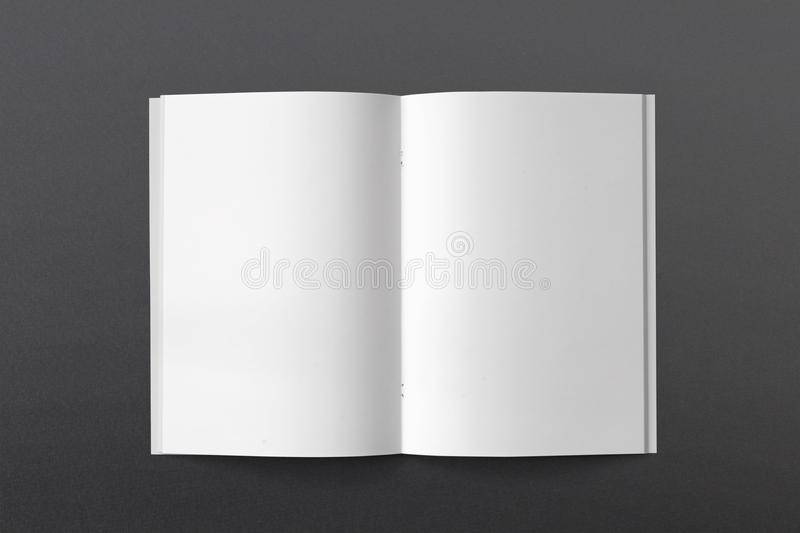 Opened Magazine or Brochure on black paper. Blank pages top view stock image