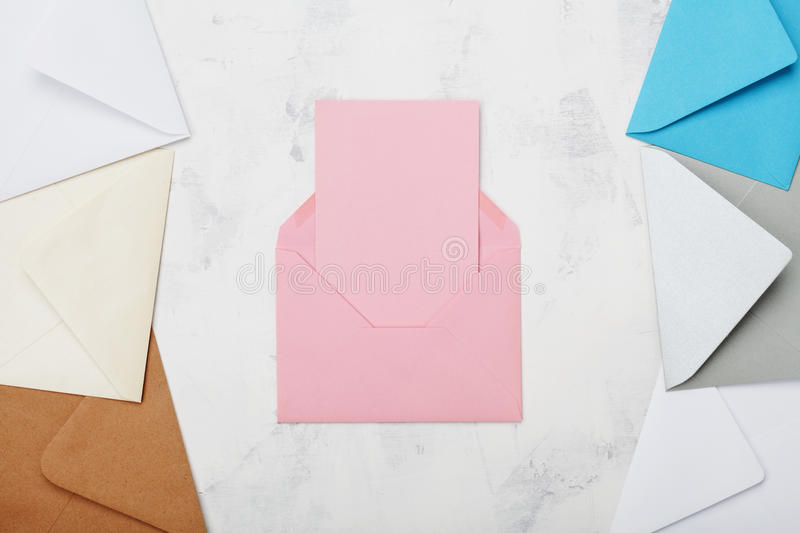 Opened mail envelope with empty card mockup or template top view. Business or private correspondence background. Flat lay. stock images