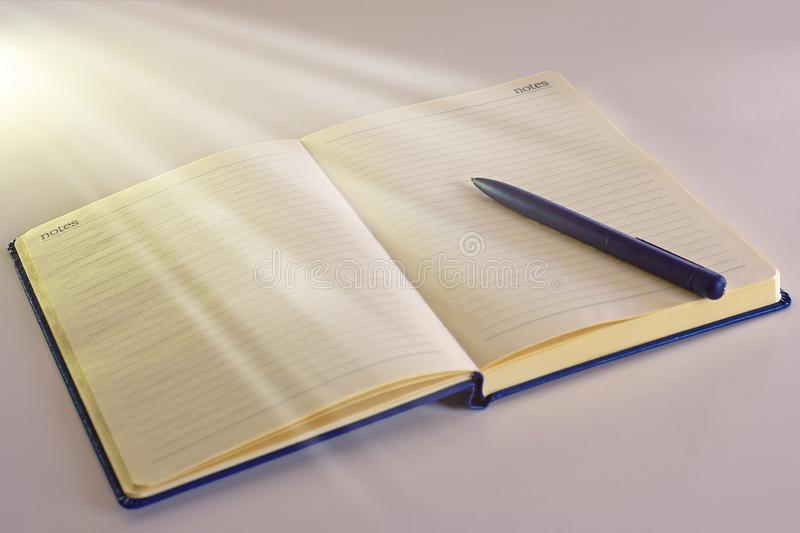 Opened notebook for tasks with pen and blank pages stock photos