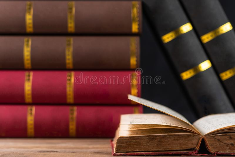 Opened old book and books background stock photo