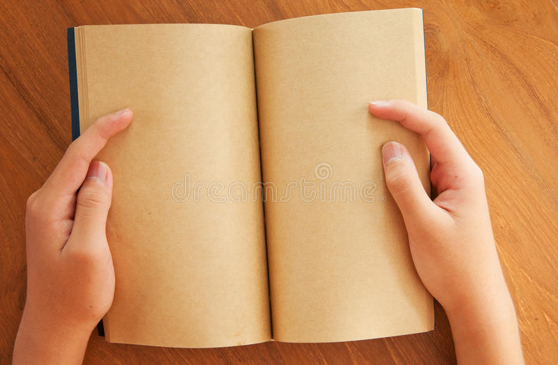 Opened Old Book In Hands Stock Photos