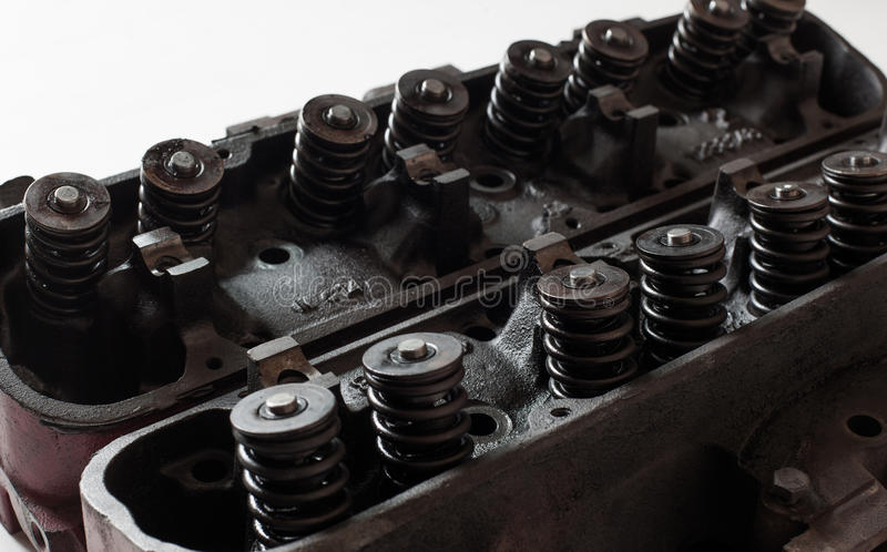 Opened old v8 engine heads showing valves and springs. Old v8 engine heads showing valves and springs stock image