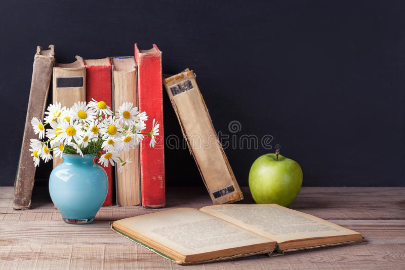 Opened old vintage book lies on a wooden rustic table. Country still life. stock image