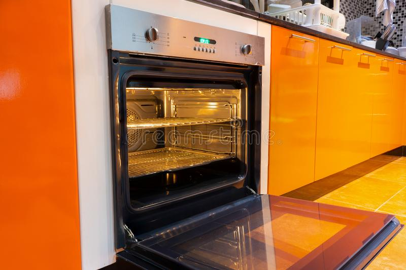 Opened oven in the kitchen stock photography