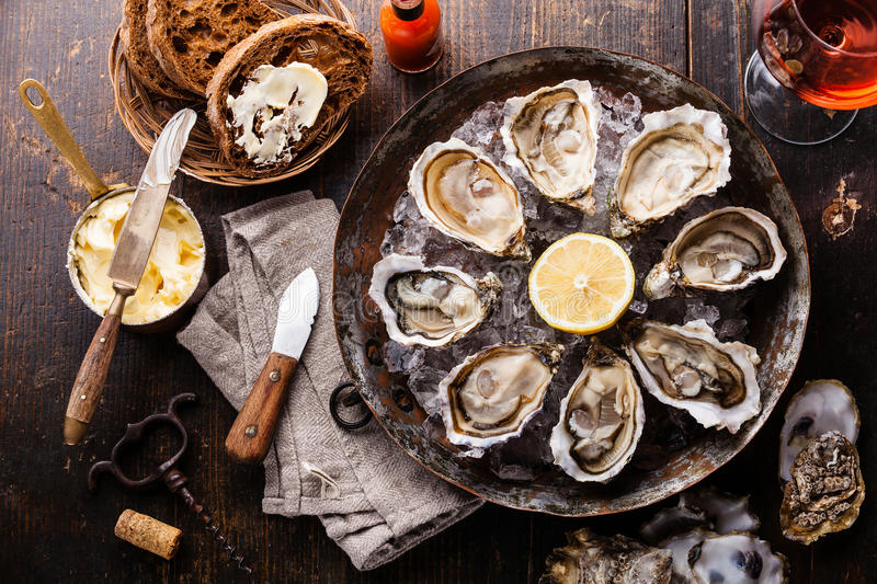 Opened Oysters with dark bread with butter royalty free stock photography