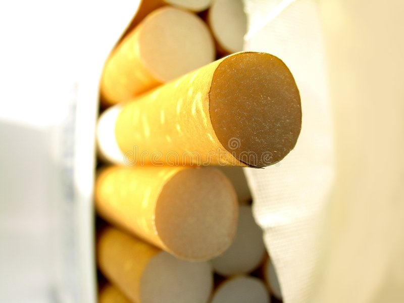 Opened pack of cigarettes royalty free stock photography