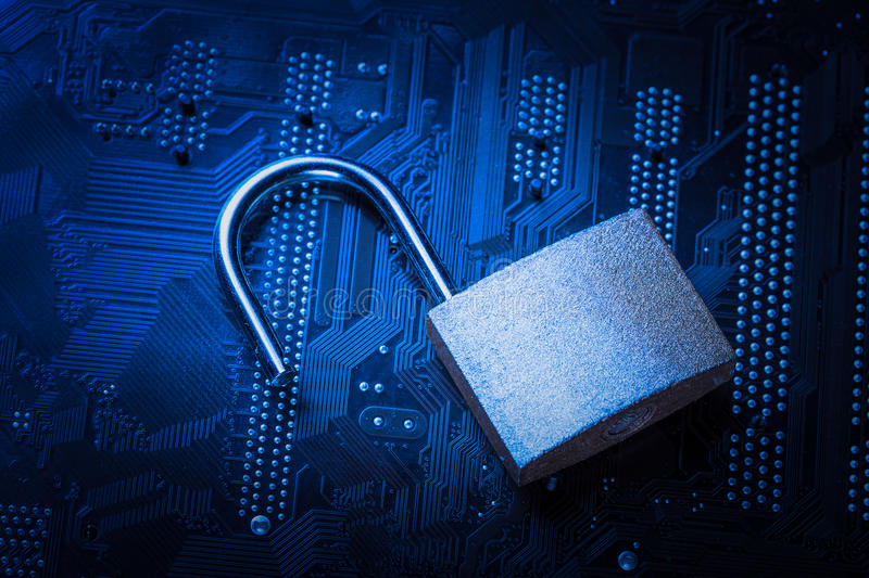 Opened padlock on computer motherboard. Internet data privacy information security concept. Blue toned image royalty free stock photos
