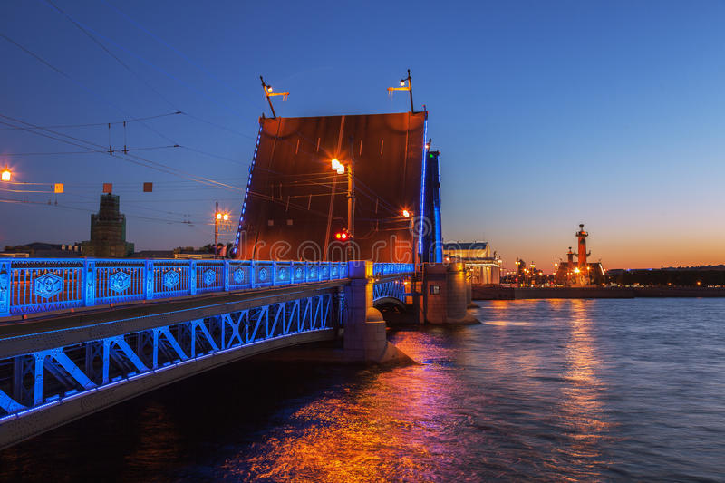 Opened the Palace bridge, White Nights in St. Petersburg, Russia. Opened the Palace bridge (drawbridge), White Nights in St. Petersburg, view of the Spit of royalty free stock photos
