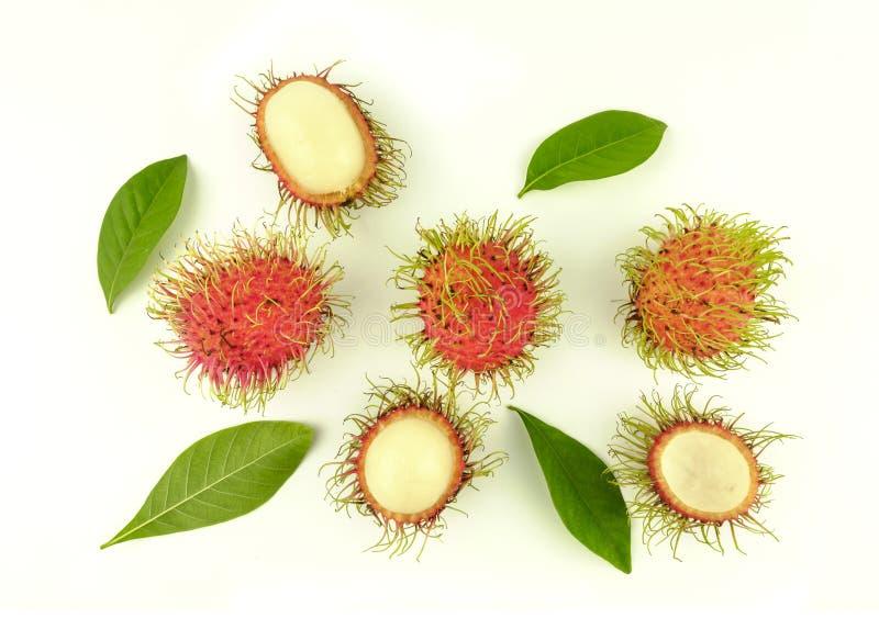 Opened rambutan fruit and leaves stock photo