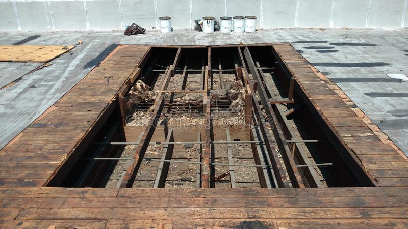 Opened roof area for roof leak repairs on Commercial flat roof; roofing stock images