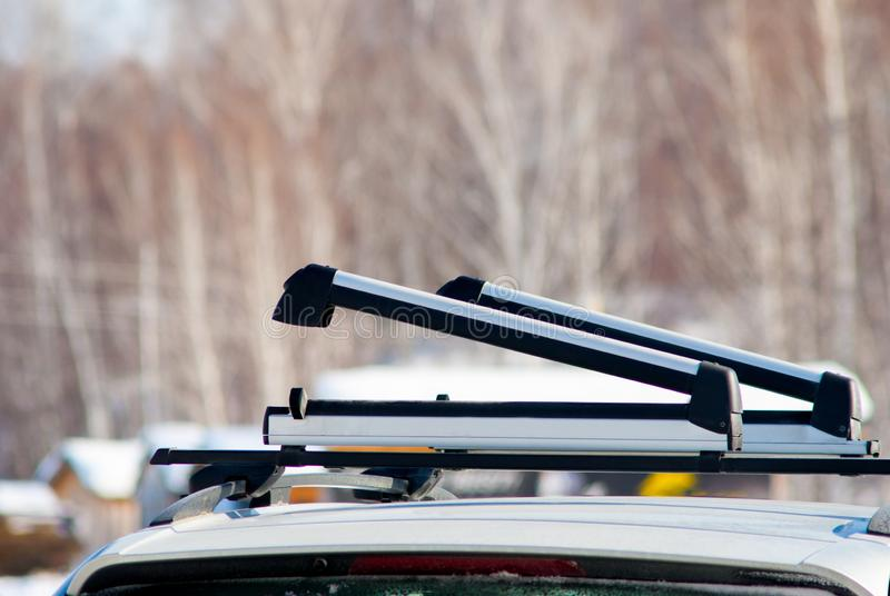 Opened ski or snowboard car roof rack. Close up shot royalty free stock image