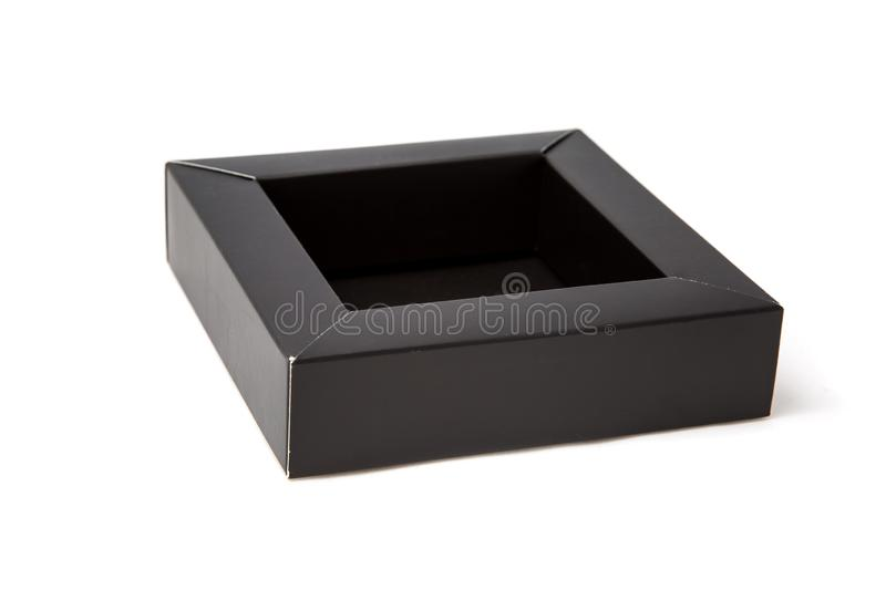 Opened small black box. Its empty inside and made from cardboard. Isolated mockup on a white background.  royalty free stock photography