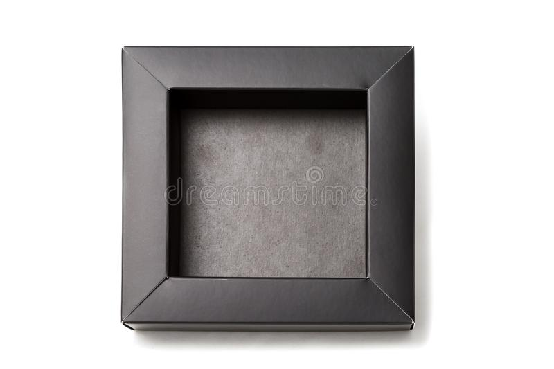 Opened small black box. Its empty inside and made from cardboard. Isolated mockup on a white background.  stock photos