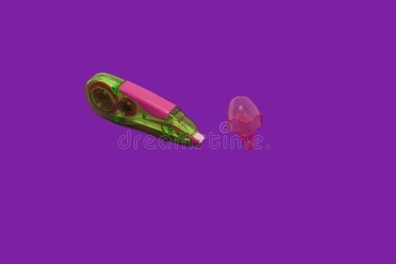 Opened tape corrector on a purple background royalty free stock photos