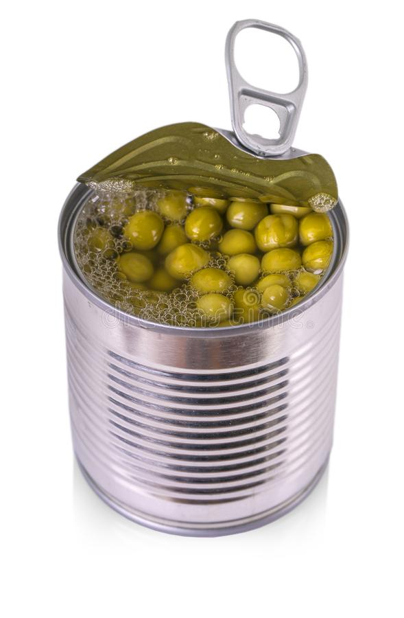 Opened tin with green peas. Isolated on white royalty free stock photo