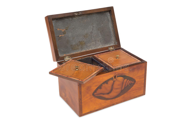 An Opened Vintage Wooden Tea Twin Caddy and Compartments. Cut-out of an opened wooden tea twin caddy and compartments royalty free stock images
