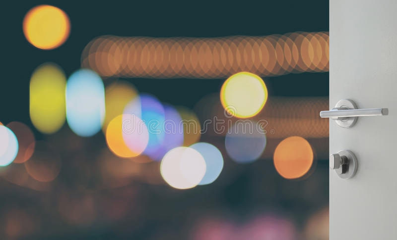 Opened white door to abstract background with bokeh defocused lights royalty free stock photos