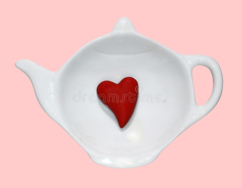 Opened white saucer cup of tea, red heart inside, isolated background, flat lay, top view. Copy space. Love coffee or tea concept stock images