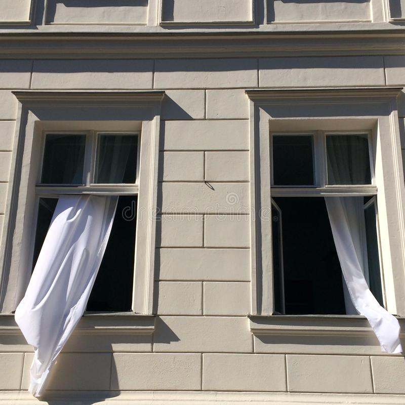 Opened Windows With White Curtains royalty free stock images