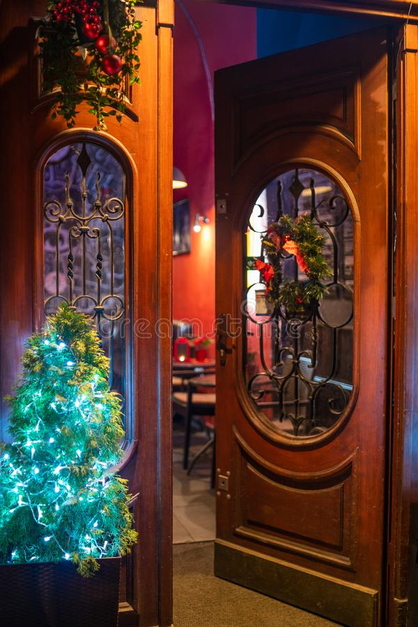 Picture of opened wooden door at christmas time at the street. Opened wooden door at christmas time at the street stock photos