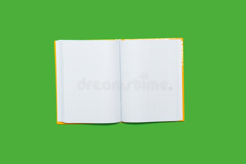 Opened workbook on a green background. White opened workbook lying on a green background. concept of business or educational equipment stock photography