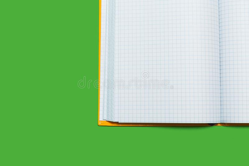 Opened workbook on a green surface. White opened workbook lying on a green surface. concept of business or educational equipment stock photo