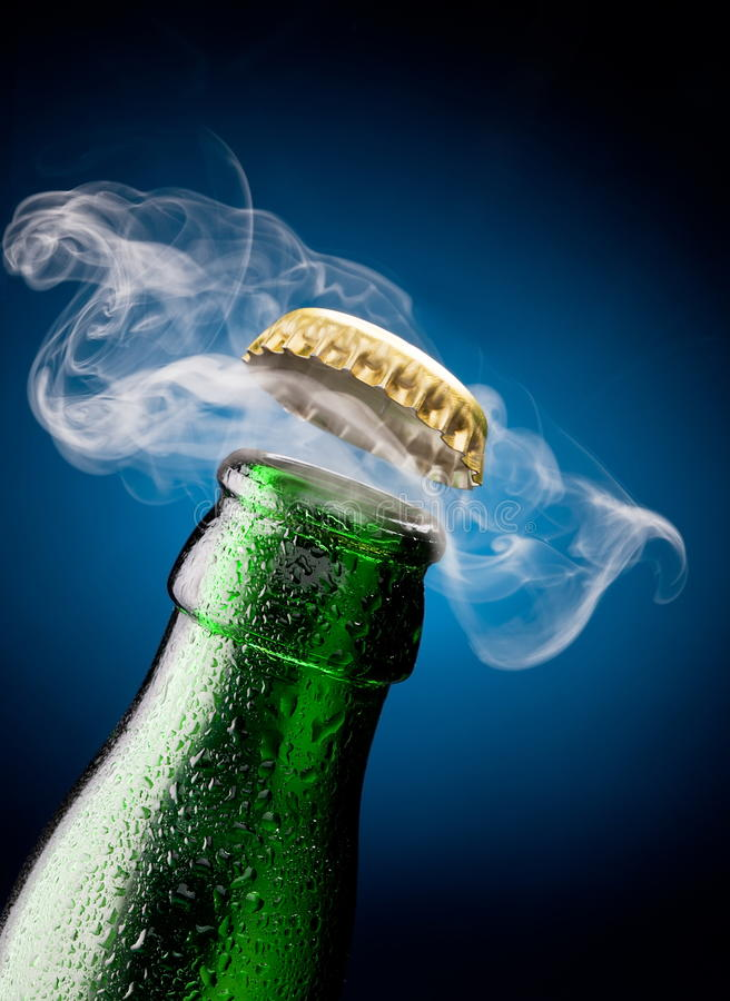 Opening of beer cap royalty free stock photography