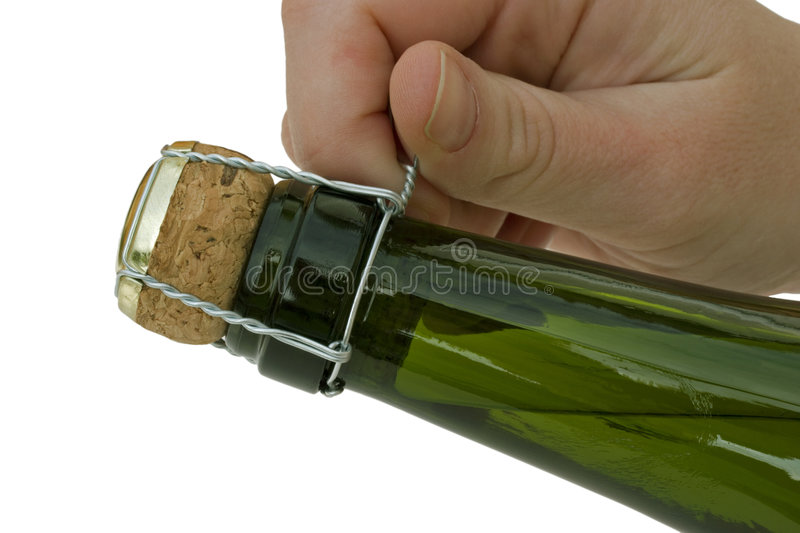 Opening a bottle of Champagne. royalty free stock images